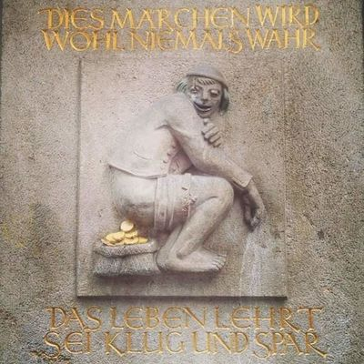 German Humor Poop Architecture Bas Relief Day King - Royal Person Marble No People Outdoors Royal Person Sculpture Statue Text