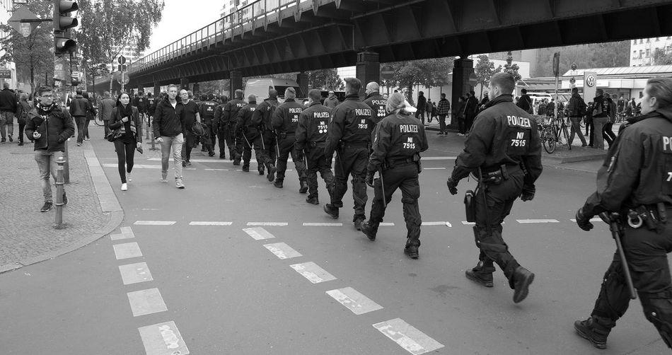MyFest 2017 Adult Armed Forces Authority Berlin Photography Berliner Ansichten Black And White Building Exterior City Day Large Group Of People Men MyFest Outdoors People Police Force Police Uniform Real People Riot Road Uniform Walking Women The Street Photographer - 2017 EyeEm Awards Strassenfilm