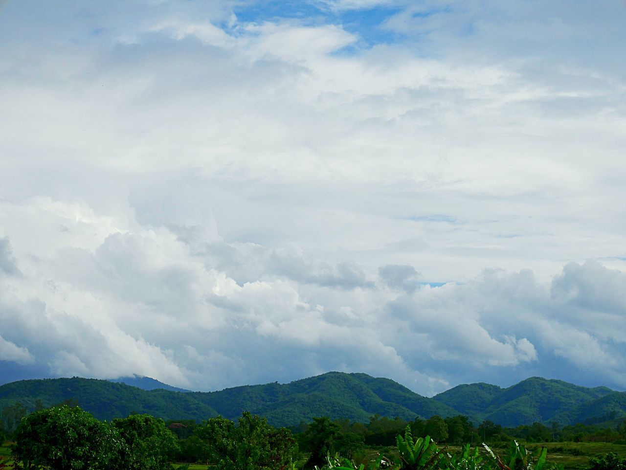 sky, tranquility, nature, beauty in nature, cloud - sky, tranquil scene, scenics, no people, mountain, day, landscape, outdoors, tree