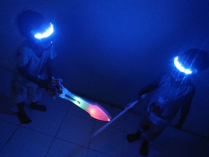 Night Illuminated People Indoors  Children Childhood Child Boy And Girl Sibling Sister And Brother Playing Sword Fight Rangers