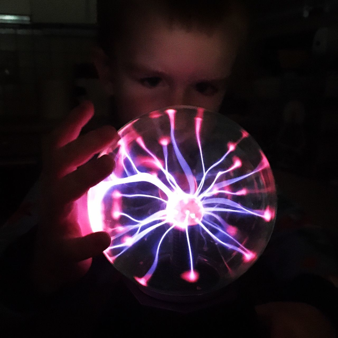 One Person Real People Holding Indoors  Childhood Close-up Human Hand Dark Night Darkness And Light Electricity  Magic Wonderful Playing Child Little Boy Electric Light Plasmaball Plasma Globe Ball Physics Science Light Plasma Plasma Ball