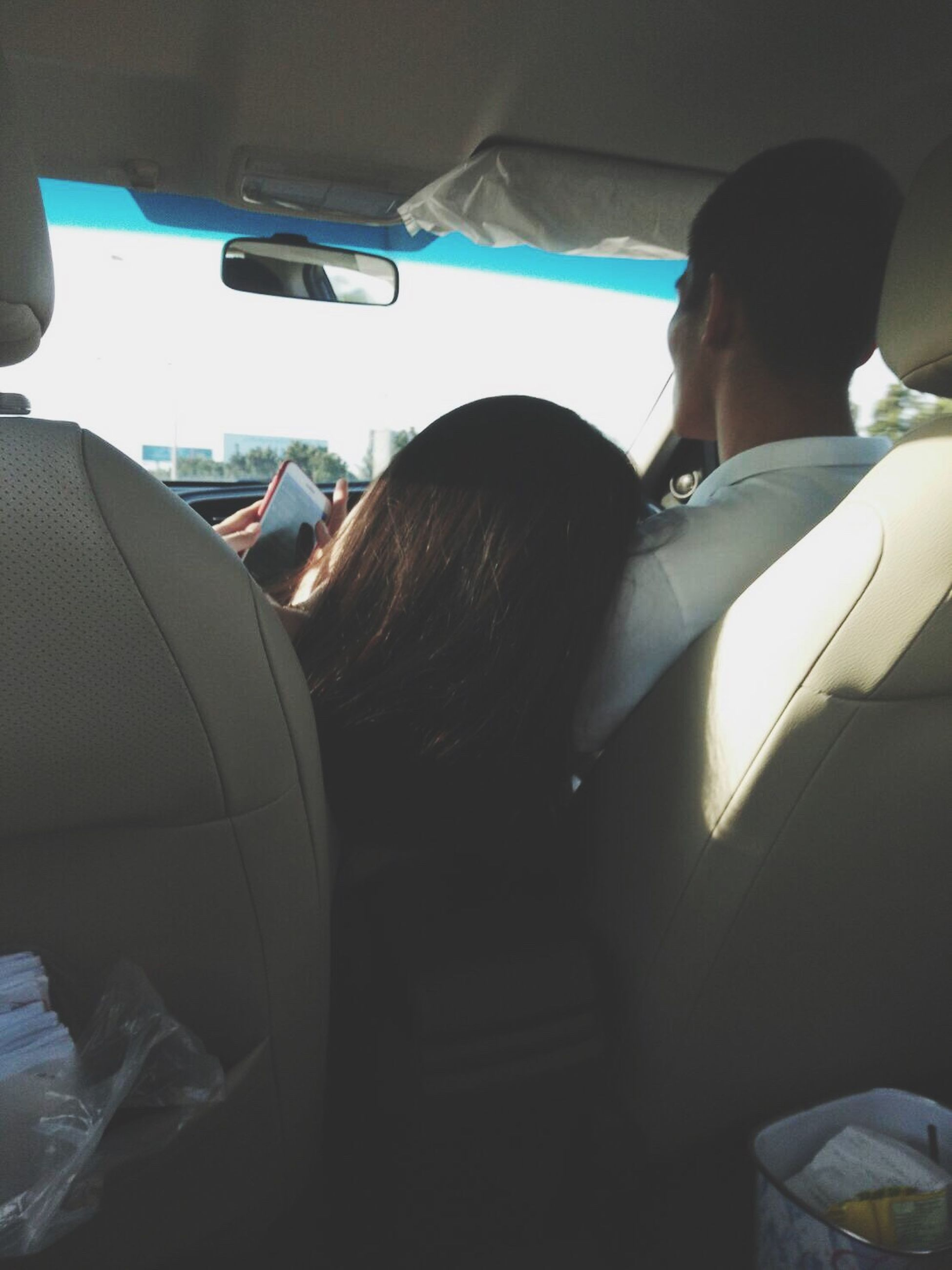 vehicle interior, car, car interior, transportation, mode of transport, land vehicle, rear view, travel, journey, real people, vehicle seat, road trip, two people, driving, young women, togetherness, friendship, women, lifestyles, day, young adult, sitting, passenger seat