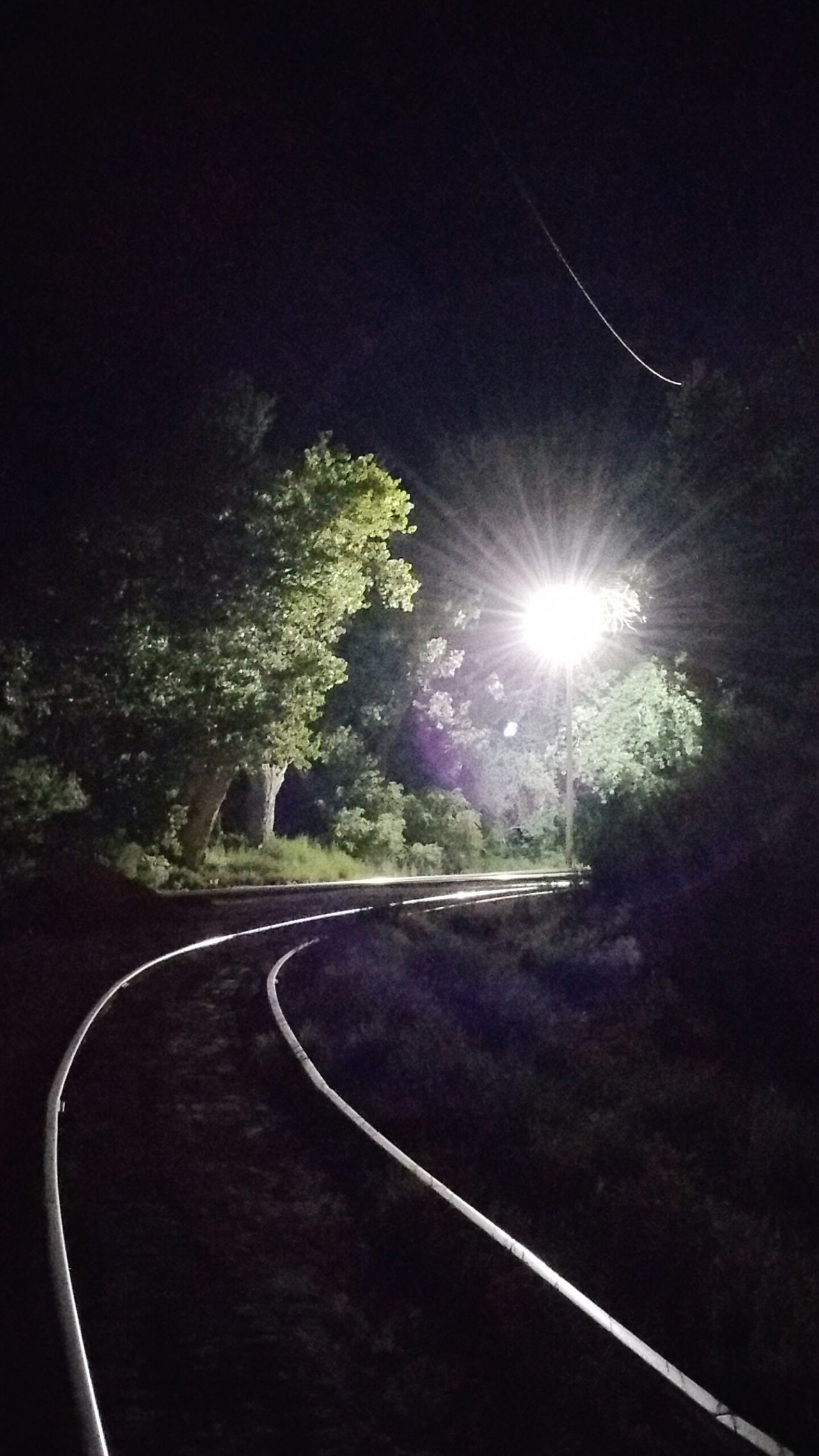 Train Tracks At Night Bright Lights On The Train Tracks Trees Tracks Night Tracks