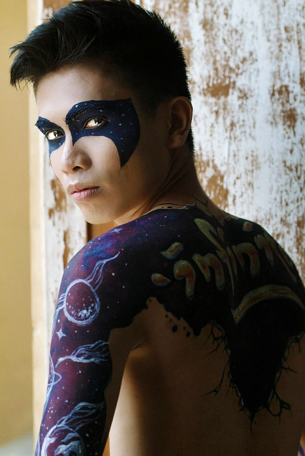 -'. secondPortraitCosmicSkies One Person Close-up Men Young Adult Photography Fashionable Fashion Photography Bodypaint Photoshoot Indoors  One Man Only Fashion Facepaint Facepainting Galaxy