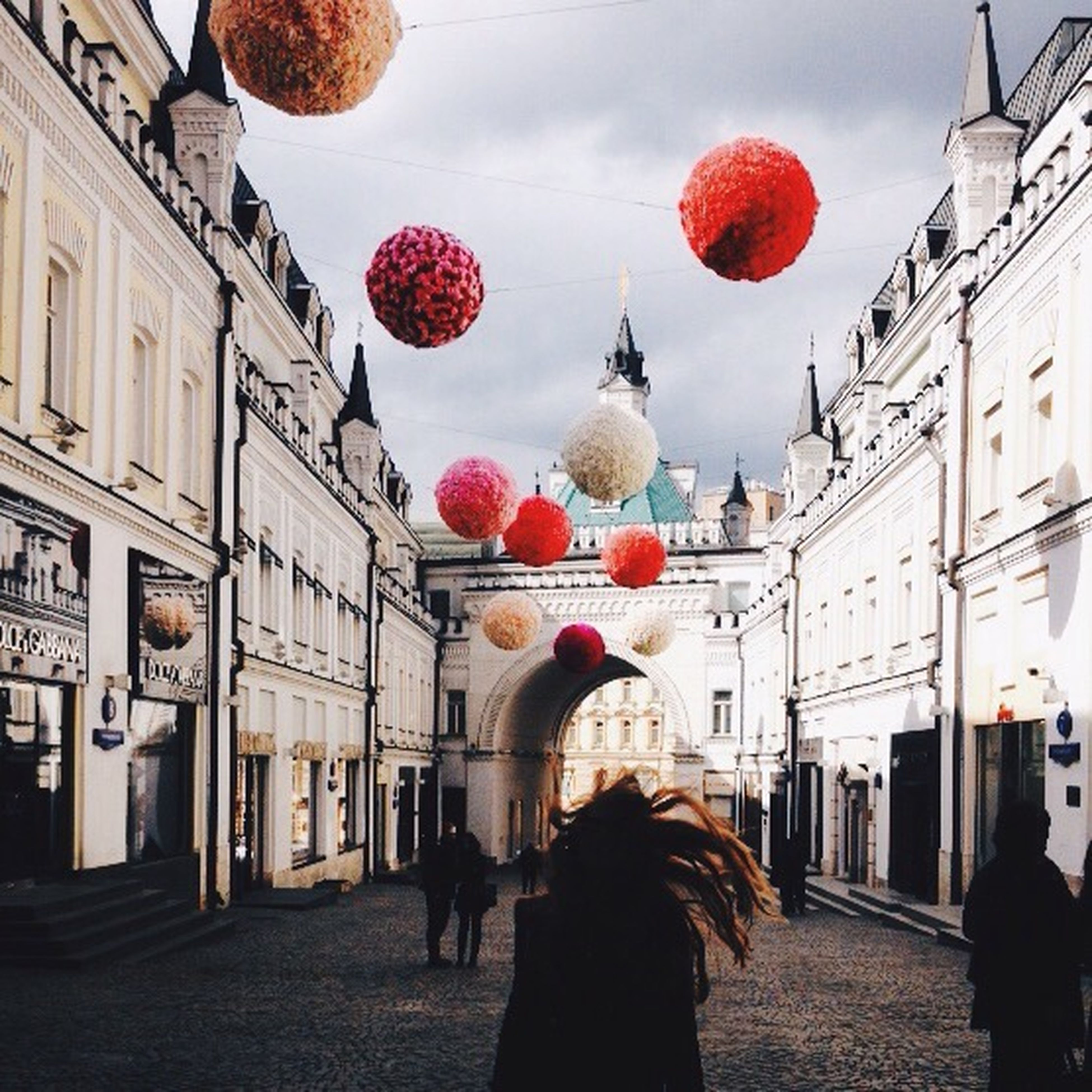 architecture, building exterior, built structure, tradition, decoration, lantern, celebration, balloon, cultures, hanging, red, traditional festival, sky, city, person, incidental people, men, outdoors, low angle view