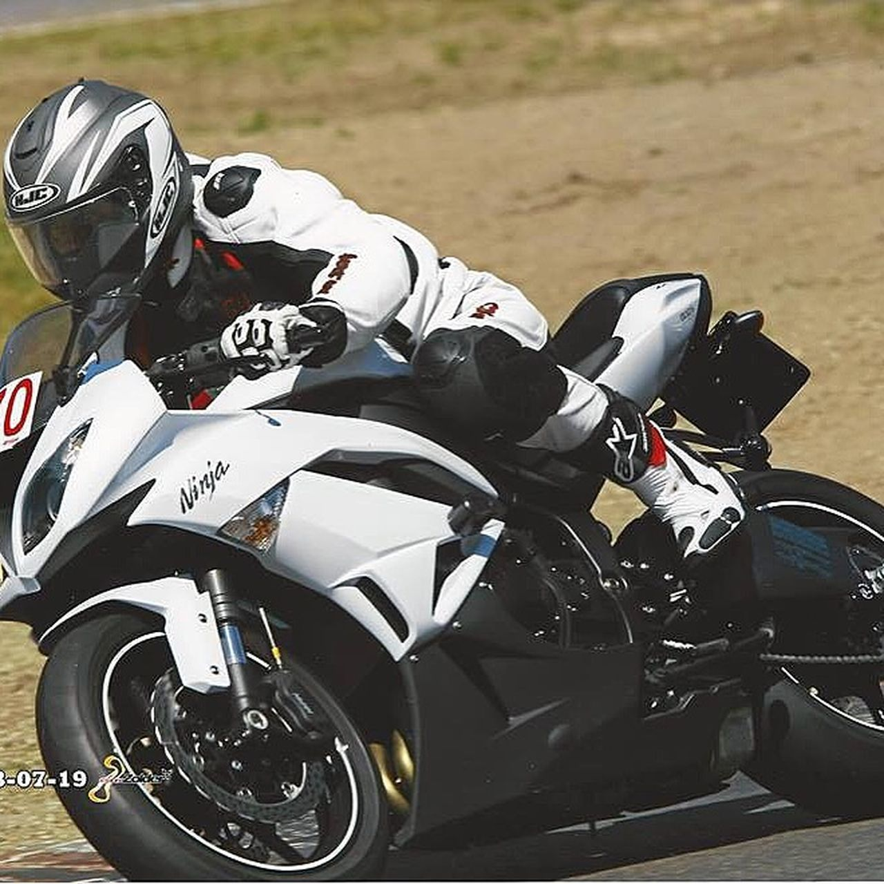 motorsport, motorcycle, sports race, crash helmet, sport, motorcycle racing, competition, speed, professional sport, sports helmet, men, mode of transport, riding, only men, people, auto racing, adults only, headwear, extreme sports, contest, group of people, outdoors, adult, biker, sports track, competitive sport, sportsman, motocross, day
