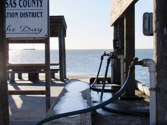 Boat Launch Dockside Water Hose Water Spicket Waterstation Cleaning Fish Waterfront Taking Photos Hanging Out Relaxing Enjoying Life Fulton Texas Calm Water Walking Around Taking Pictures Sunny Day Boat Ramp Dockside View Beauty In Nature