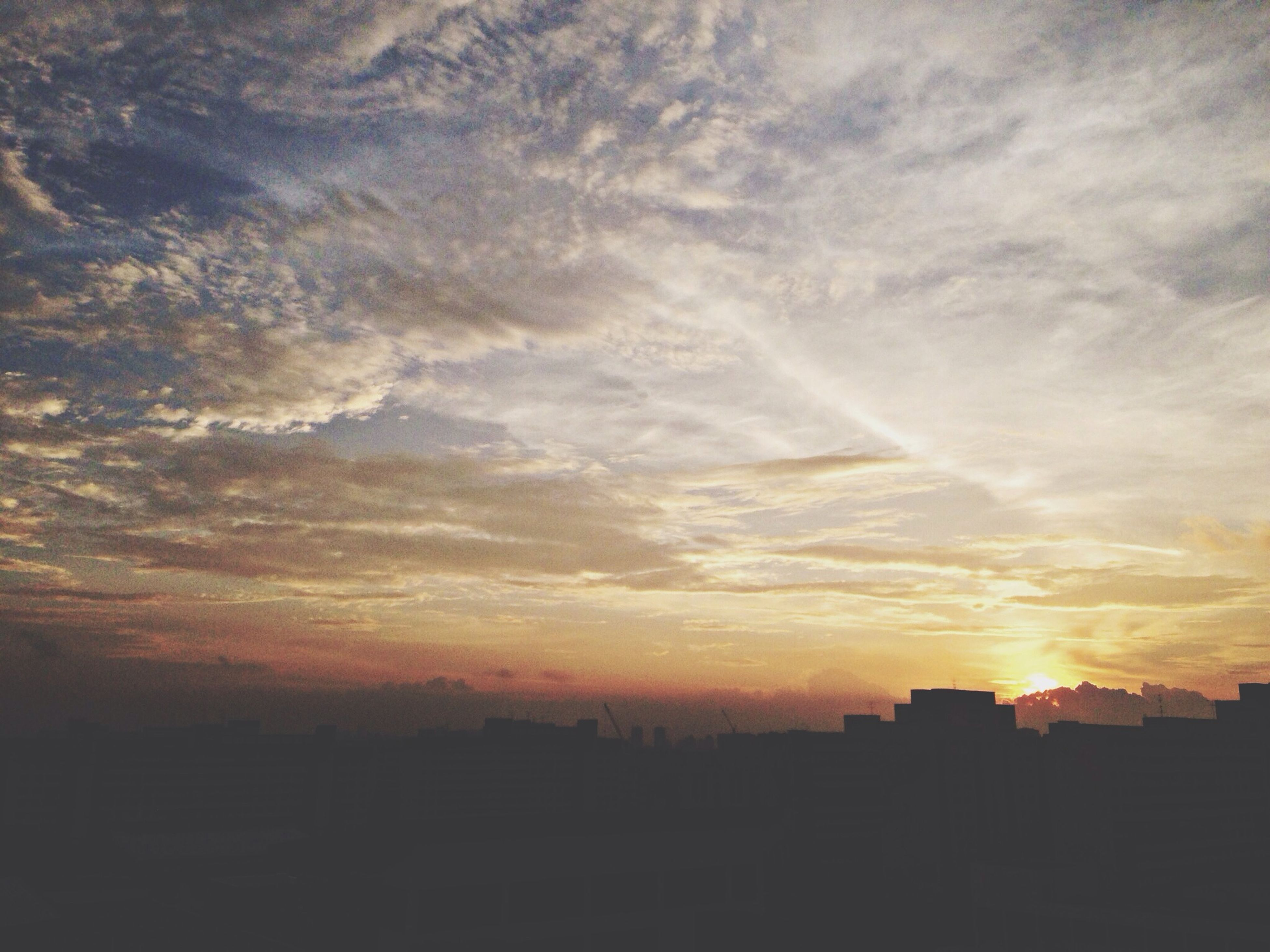 sunset, sky, building exterior, silhouette, orange color, built structure, architecture, cloud - sky, scenics, beauty in nature, nature, cloud, tranquility, tranquil scene, idyllic, city, cloudy, sunlight, outdoors, sun