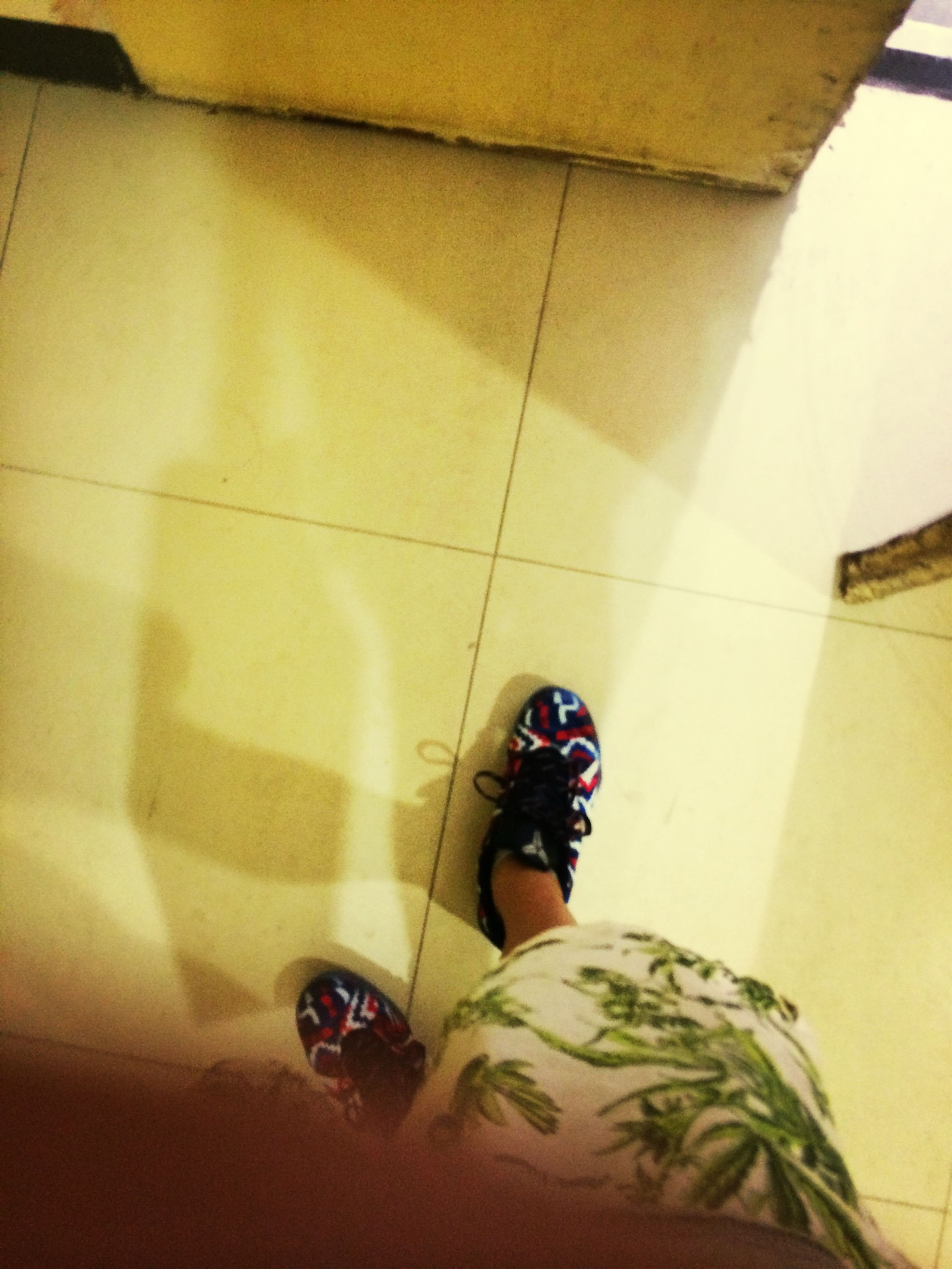 low section, person, shoe, lifestyles, indoors, personal perspective, human foot, high angle view, flooring, tiled floor, footwear, standing, leisure activity, floor, men, casual clothing