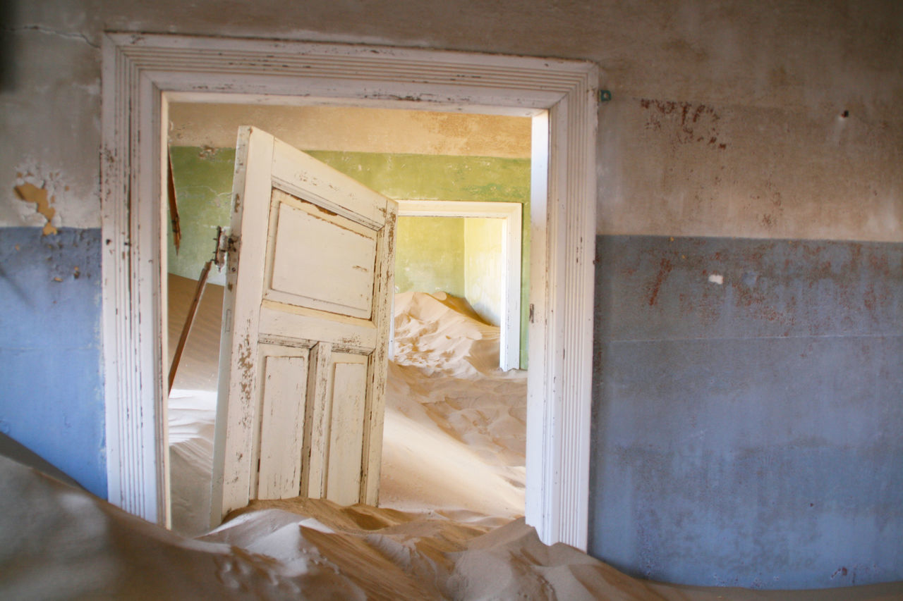 Africa Damaged Dirty Ghost Town House Indoors  Keetmanshoop Messy Namibia Nature Photography Nature Takes Over No People Old Buildings Old Town Peeling Off Sand Steps And Staircase Unreal Weathered Yellow