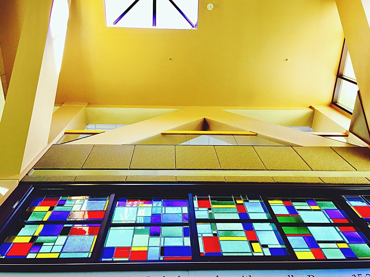 Looking straight up in the lobby of a hospital Indoors  No People Neat Architecture Day Fresh To Eye Em Iphonephotography Taking Photos ❤ Stained Glass Window shadows Shadows & Lights