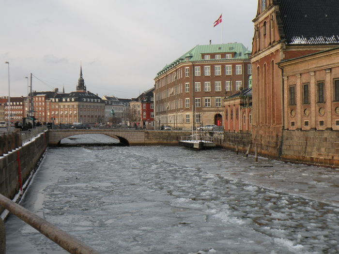 Late winter in Copenhagen, Denmark - Winter Ice Water Canal City Outdoors Architecture Bridge Sky Day Building Exterior Built Structure Cityscape People - at Frederiksholm's Canal in Copenhagen, Denmark