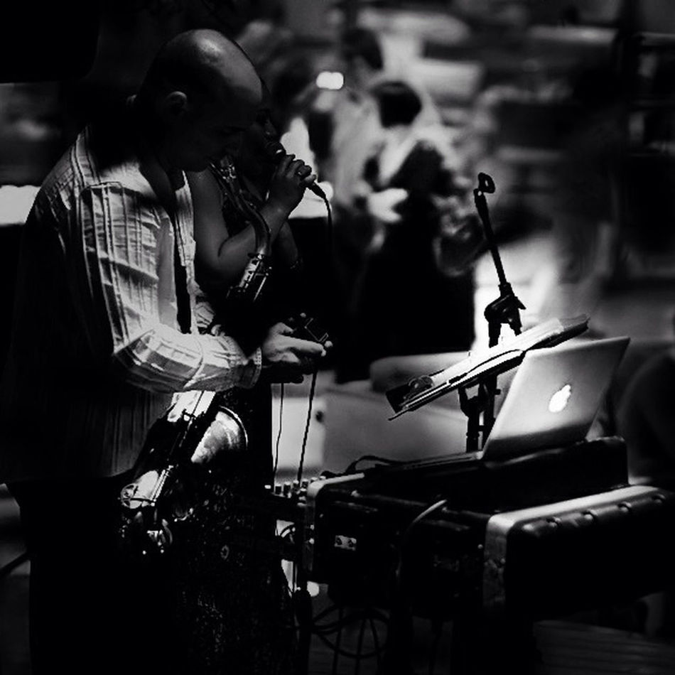 A sax man , the girl in the bar and the macbook.