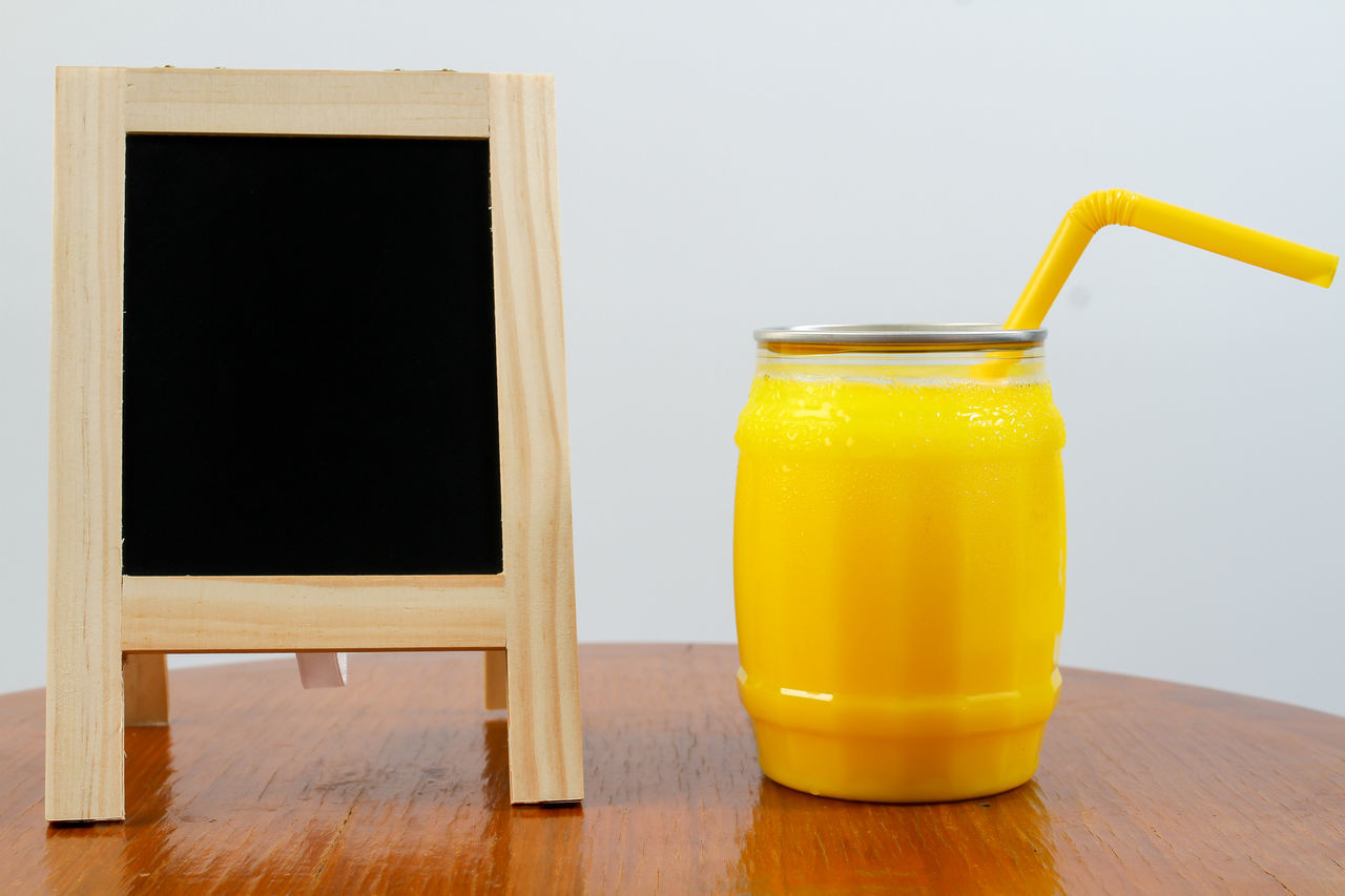 yellow, table, drink, refreshment, wood - material, no people, drinking glass, close-up, indoors, healthy eating, freshness, food, day