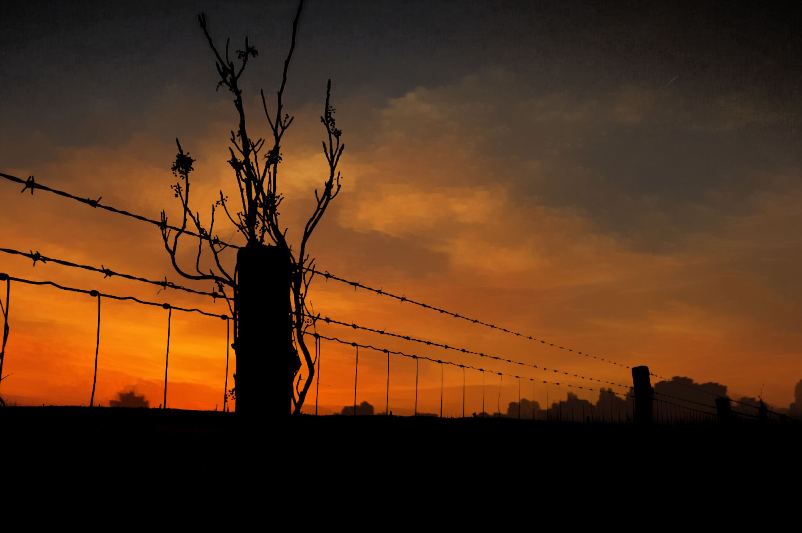 sunset, silhouette, orange color, sky, power line, electricity pylon, beauty in nature, nature, scenics, tranquility, power supply, connection, electricity, dark, fence, landscape, tranquil scene, low angle view, cloud - sky, no people