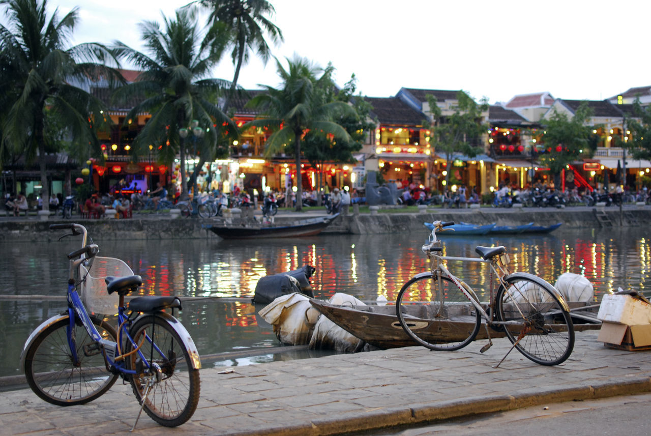 Dusk in Hoi An, Vietnam Architecture Bicycle Building Exterior Built Structure Cycle Hoi An Hoi An, Vietnam Illuminated Land Vehicle Mode Of Transport Palm Tree Person Reflection Stationary Tourism Transportation Travel Vacations Vietnam Water