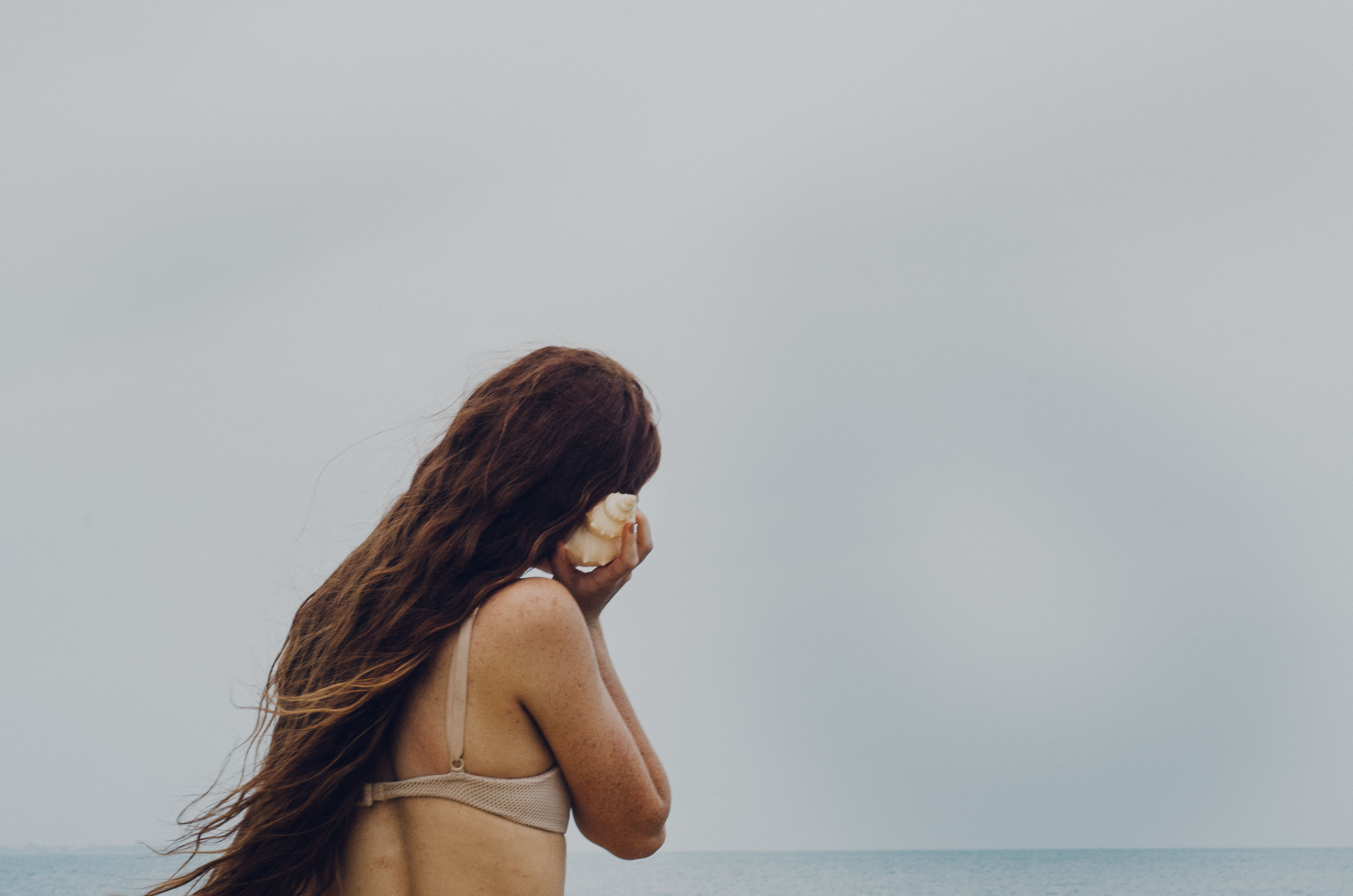 Calling Home Young AdultLeisure Activity Tranquility Horizon Over Water Nature Women Sea Long Hair Outdoors Live For The Story