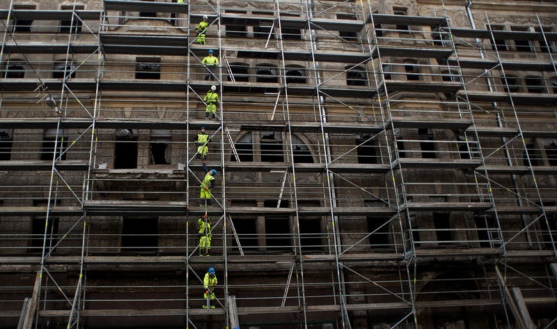 Construction workers row on scaffolds Construction Construction Site Construction Machinery Scaffolding Work Workman Architecture Business Finance And Industry Construction Industry Construction Vehicle Construction Work Construction Worker Day Full Frame Outdoors Real People Row Safety Helmet Scaffold Vertical Workingman Workmen Fashion Stories Business Stories