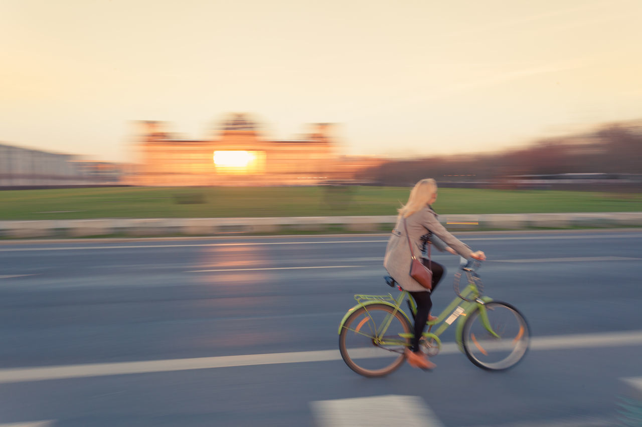 Biking on city road at Reichstag in Berlin, motion blur zoom effect at sunset Bike Biycycle Blur Blurred Motion Cycling Day Driving Full Length Motion Moving On The Move One Person Outdoors People Real People Reichstag Riding Road Road Sky Speed Street Sunset Sunsets Traffic