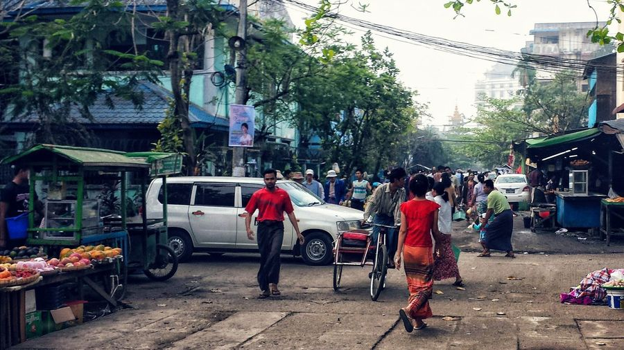 Street Large Group Of People Person Tree Full Length Lifestyles Men City Building Exterior Built Structure Architecture Walking Road Casual Clothing Retail  City Life Group Of People Day City Street Crowd Yangon Myanmar Rangoon Myit Ta Nyunt The City Light The Street Photographer - 2017 EyeEm Awards The Photojournalist - 2017 EyeEm Awards