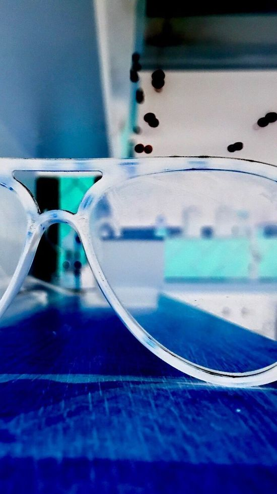 In my kitchen Threw My Sunglasses Indoors  No People Close-up Research Technology playing around with iPhone 7 magnifying camera & filters . How ? Home button 3 times Art Is Everywhere EyeEm EyeEm Gallery EyeEm Vision Sunglasses