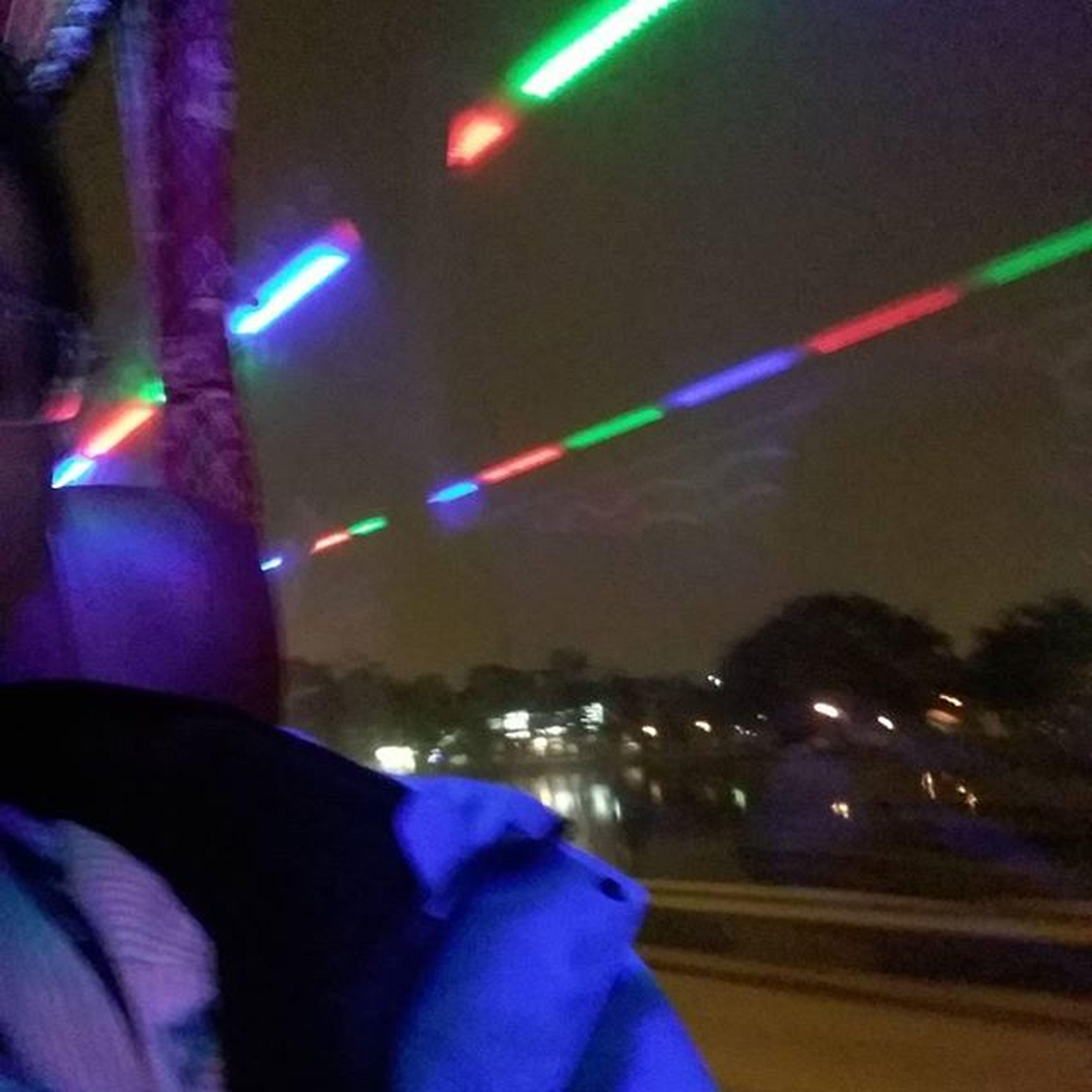 illuminated, night, defocused, light - natural phenomenon, lighting equipment, multi colored, nightlife, light trail, blurred motion, blue, long exposure, transportation, light, glowing, arts culture and entertainment, nightclub, motion, light beam, speed, road