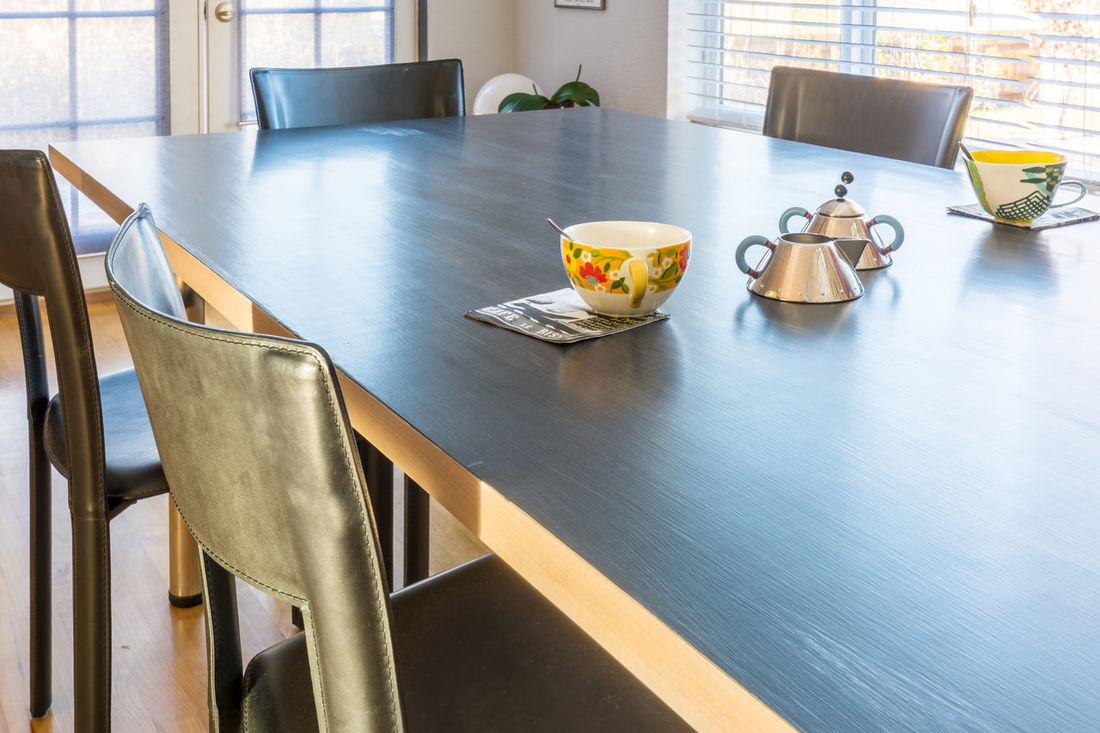 Large table with coffee cups, milk can, and sugar. Chair Coffee Time Day Dining Table Domestic Room Furniture Interior Design Interior Style No People Real Estate Photography Table