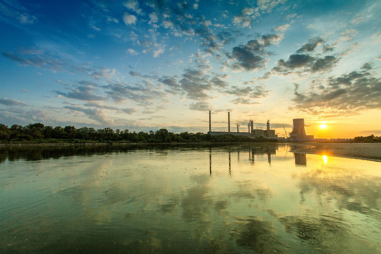 Power Stations Beauty In Nature Blue Cloud Cloud - Sky Idyllic Nature No People Non-urban Scene Orange Color Outdoors Reflection Rippled Scenics Sky Sun Sunbeam Sunset Tranquil Scene Tranquility Water