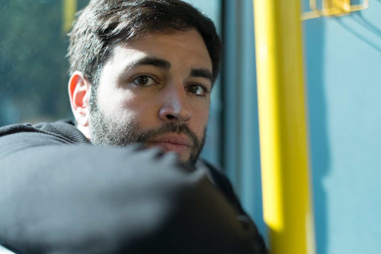 Portrait of young man traveling in train