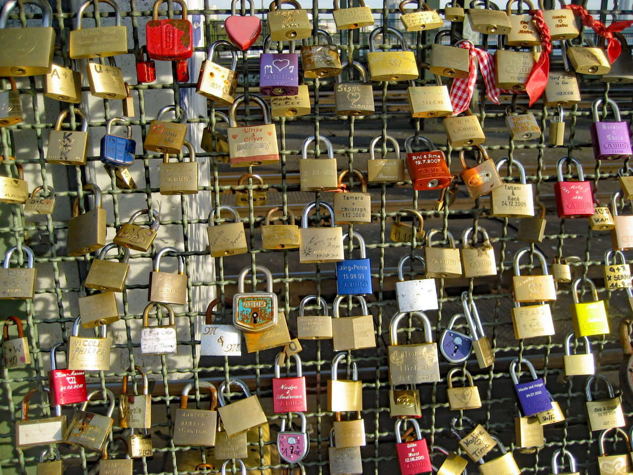large group of objects, abundance, hanging, padlock, variation, love, no people, full frame, backgrounds, day, outdoors, multi colored, close-up
