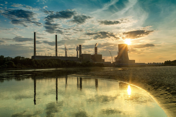 Power Stations Architecture Beauty In Nature Built Structure Cloud Cloud - Sky Idyllic Lens Flare Nature No People Orange Color Outdoors Reflection Rippled River Scenics Sky Sun Sunbeam Sunlight Sunset Tranquil Scene Tranquility Water Waterfront