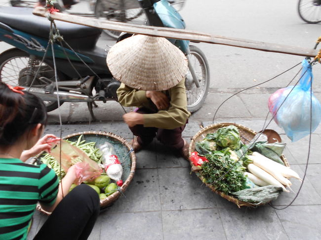 Hanoi's old quarter is full of woman trying to make an honest living by selling, vegetables, sweets and nuts from their bamboo baskets which they balance on their shoulders. Most of these woman walk the distance from the other side of the Red River to the old quarter every day to make enough to feed and clothe their family members. Bamboo Basket Buying Food Food And Drink Freshness Hanoi Lifestyles Old Quarter Person Real People Selling Vegetab Vietnam Vietnamese Woman , Woman Who Inspire You Working Here Belongs To Me