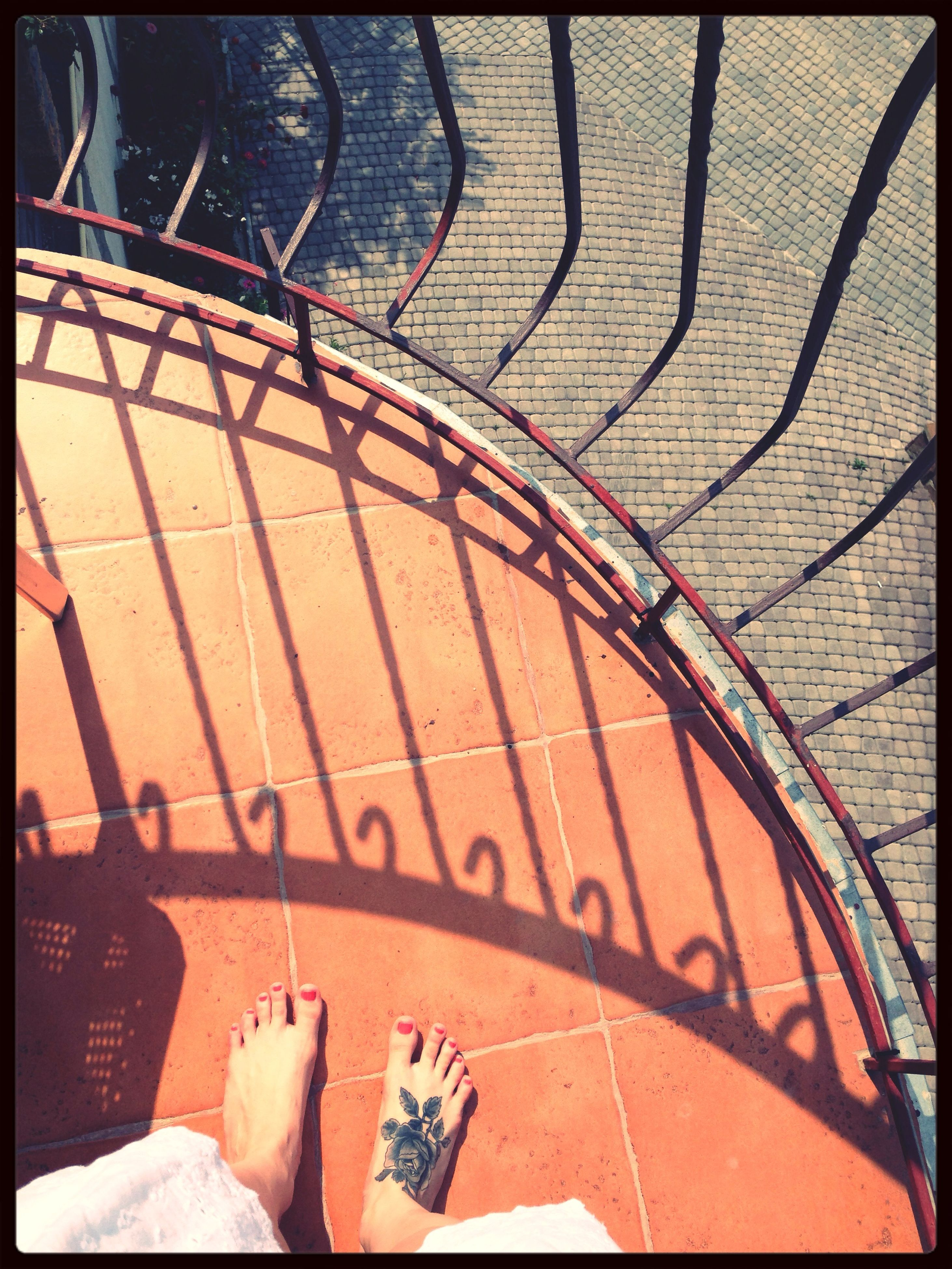 transfer print, auto post production filter, high angle view, shadow, low section, sunlight, day, part of, person, outdoors, close-up, pattern, personal perspective, shoe, cropped, unrecognizable person