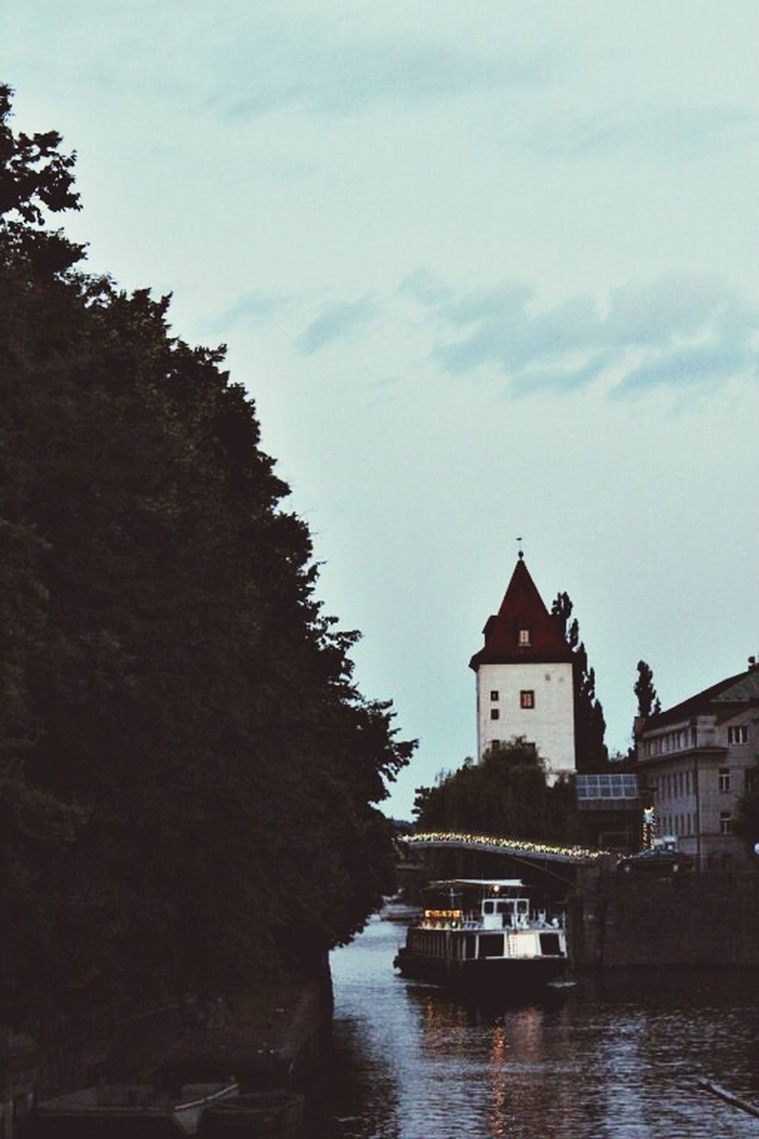 architecture, building exterior, built structure, water, waterfront, sky, tree, river, reflection, cloud - sky, lake, canal, house, cloud, church, outdoors, religion, nature, day