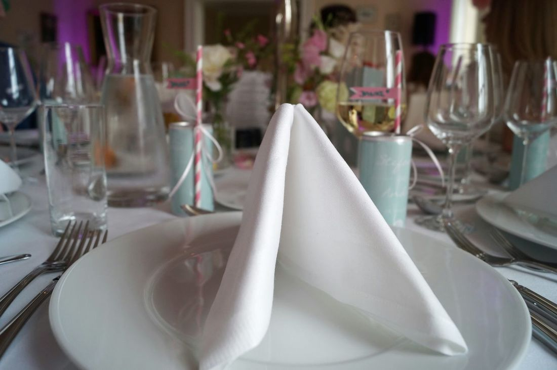 Decoration On The Table Wedding Decoration Glasses Vine Glass Plates Little Flags Flowers On Table Drinking Straw Pastel Colors Stripes Pattern Table Water Bottle  Cutlery Table Setting Napkin Vase White Tablecloth Wedding Photography People In The Background Happy Day White Ribbons Drink Pink And White Full Frame
