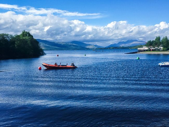 Water Waterfront Sky Blue Boat Beauty In Nature Remote Mountains Landscape Nature Tranquil Scene Rural Scene Outdoors Day Tourism Scenics Mountain Range Tree Cloudy Cloudscape LochLomond Bhoy