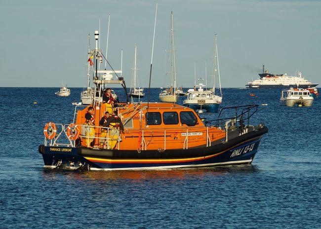 Swanage Lifeboat Lifeboat RNLI Lifeboat Crew Crew Volunteers Volunteering Seaside Coast Coastal Dorset Coast Dorset Orange
