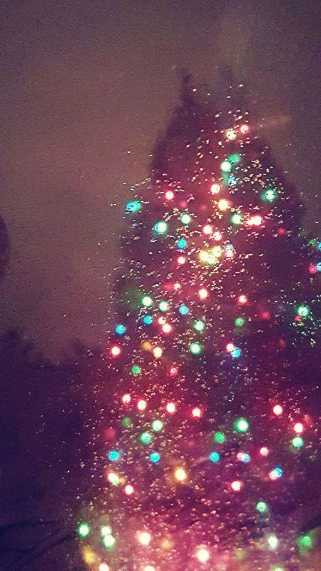 Multi Colored Illuminated Igniting Celebration No People Exploding Particle Close-up Christmas Tree Rain On Glass Night Christmas Lights Holiday Decor