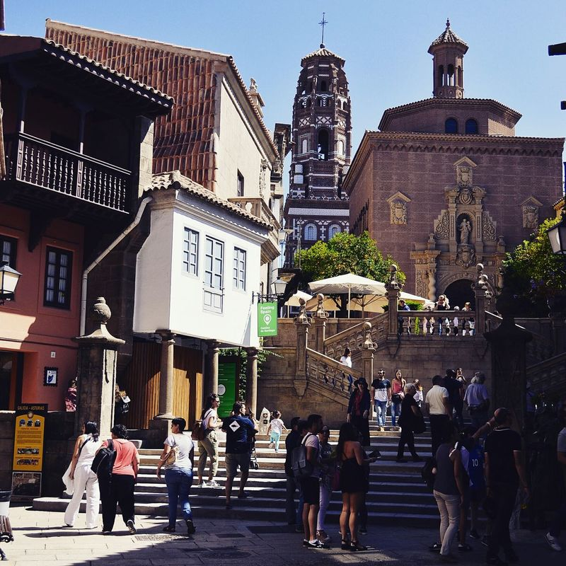 Architecture Building Exterior Large Group Of People Built Structure Travel Destinations Walking Day Outdoors Tree Adult People Sky Pedestrian City Clock Adults Only Clock Face Barcelonacity Poble Espanyol
