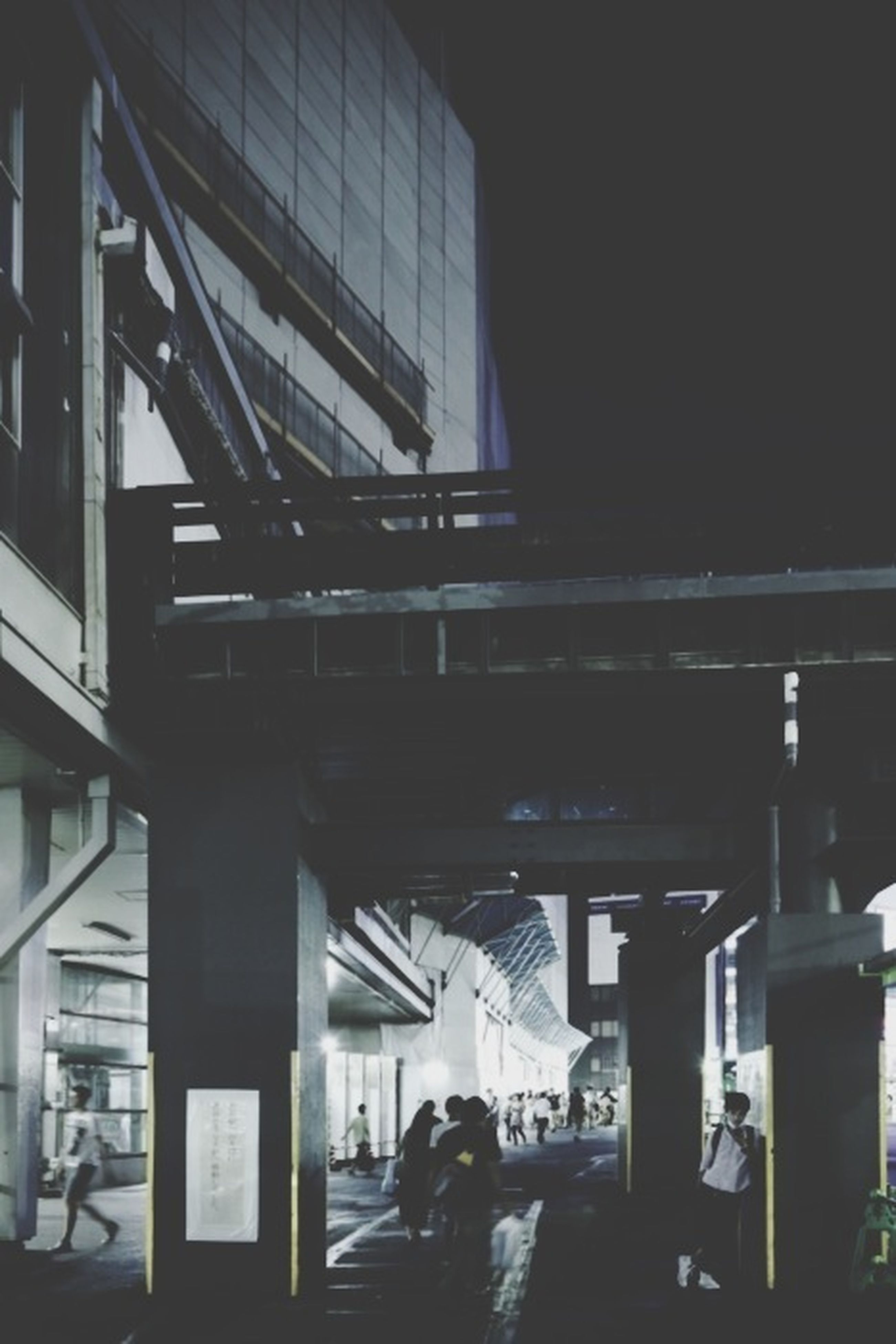 architecture, indoors, built structure, men, lifestyles, person, leisure activity, building exterior, architectural column, incidental people, walking, city life, transportation, city, group of people, ceiling, rear view, modern