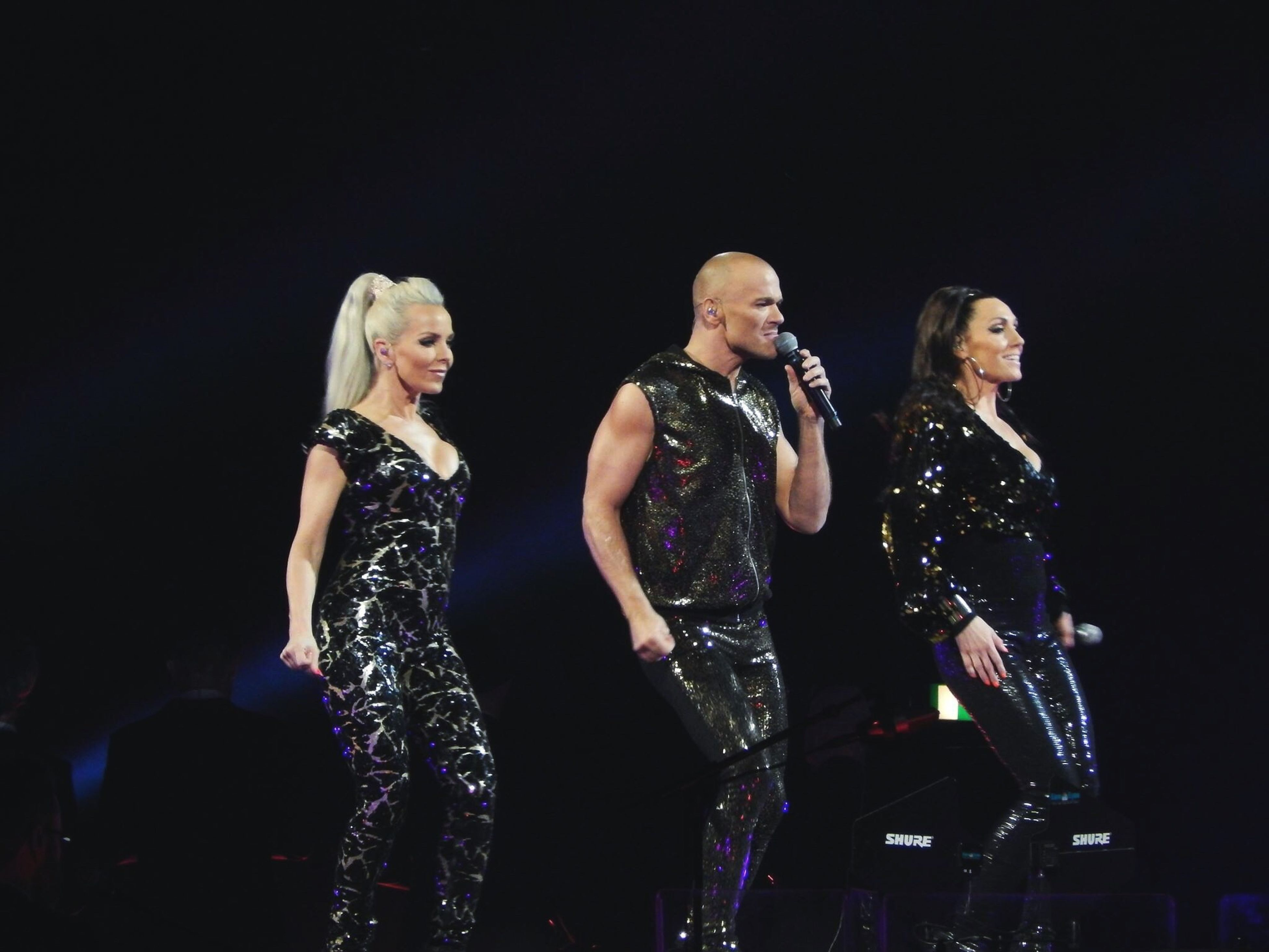 performance, music, stage - performance space, arts culture and entertainment, fame, glamour, blond hair, people, adults only, microphone, singer, performing arts event, singing, young adult, night, stage light, illuminated, nightlife, musician, adult