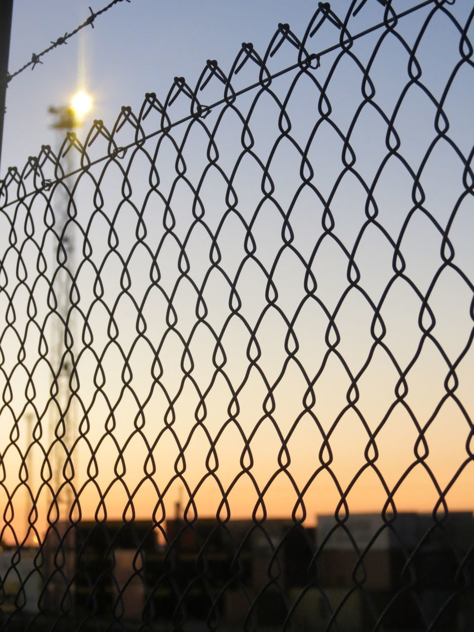 fence, chainlink fence, protection, security, safety, metal, sky, sunset, outdoors, no people, clear sky, technology, day, close-up