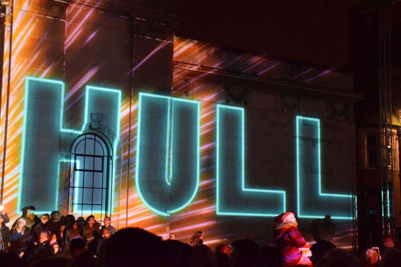 Hull City of Culture 2017, building illuminated during Made In Hull festival week (1 Jan 2017) Arts Culture And Entertainment Crowd Hull Hull 2017 Hull City Of Culture 2017 Hull2017 Illuminated Indoors  Large Group Of People Leisure Activity Lifestyles Men Night Nightlife People Real People Stage - Performance Space Technology Togetherness Women