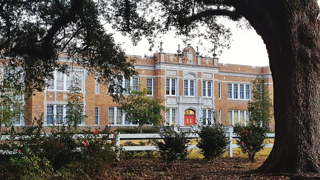 Old school Architecture Window Built Structure Building Exterior House Façade Tree Residential Building No People Day Outdoors Sky Architectural Detail Architectural Feature Details Textures And Shapes Red Door Architecture Mobliephotography South Louisiana Brick Buildings Bric
