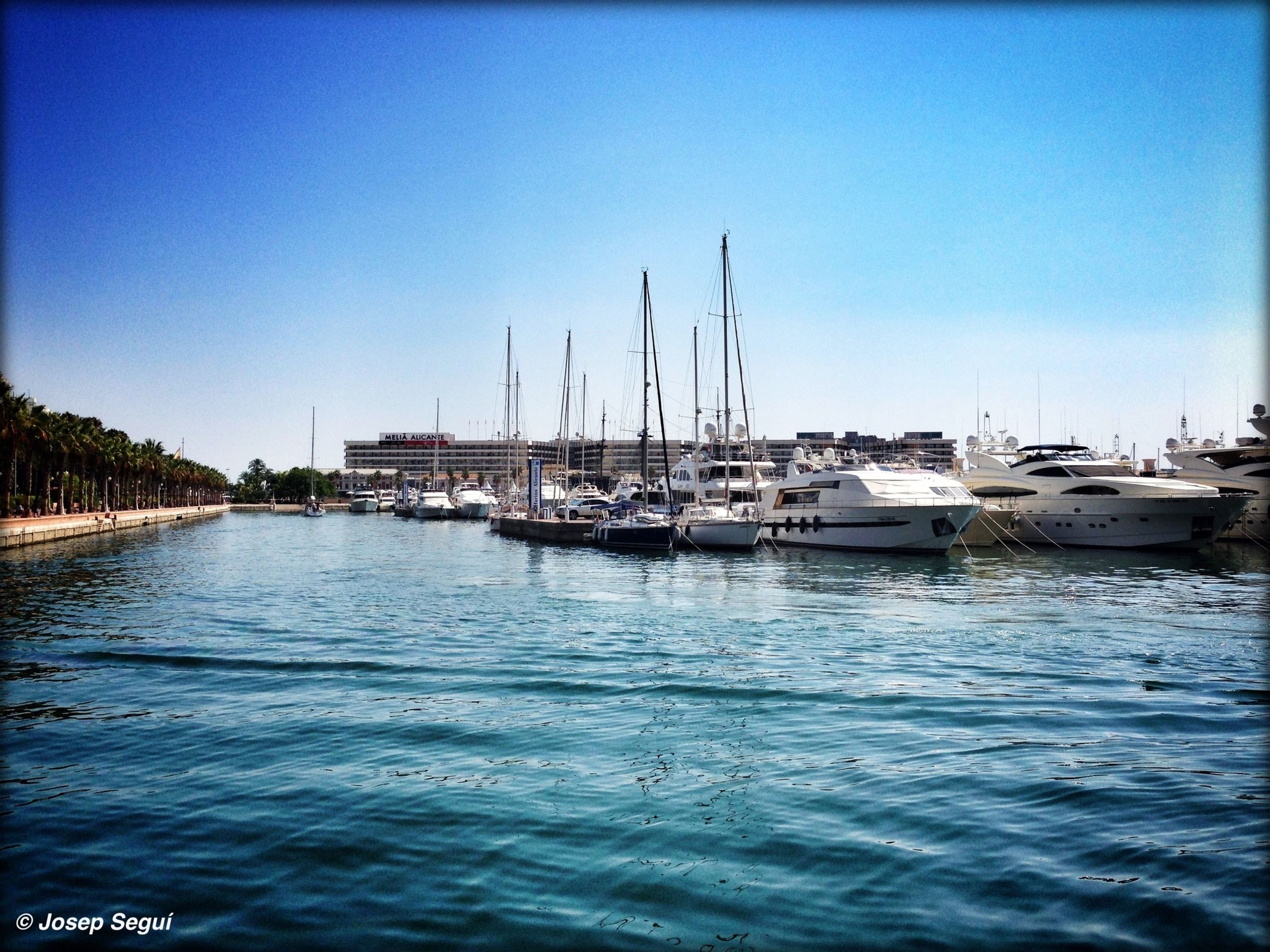 nautical vessel, water, boat, transportation, moored, mode of transport, clear sky, waterfront, blue, copy space, harbor, transfer print, sailboat, sea, mast, auto post production filter, nature, rippled, lake, tranquil scene