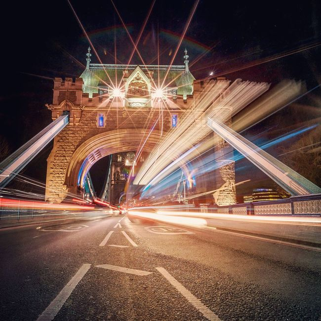 Tower Gateway | There are 2 things I love about this shot. 1. The exposure ended just in time so the bus destination can still be read. 2. Tower Bridge looks like the gaping mouth of a fire breathing beast!! Architecture Transportation Long Exposure Illuminated Motion Bridge - Man Made Structure Road Marking Light Trail City Life Arch Tower Bridge  London Cityscapes Night Lights City Lights London By Night City By Night Bus Traffic Lights Road Traffic City Traffic Busy Street Busy City London Streets London At Night