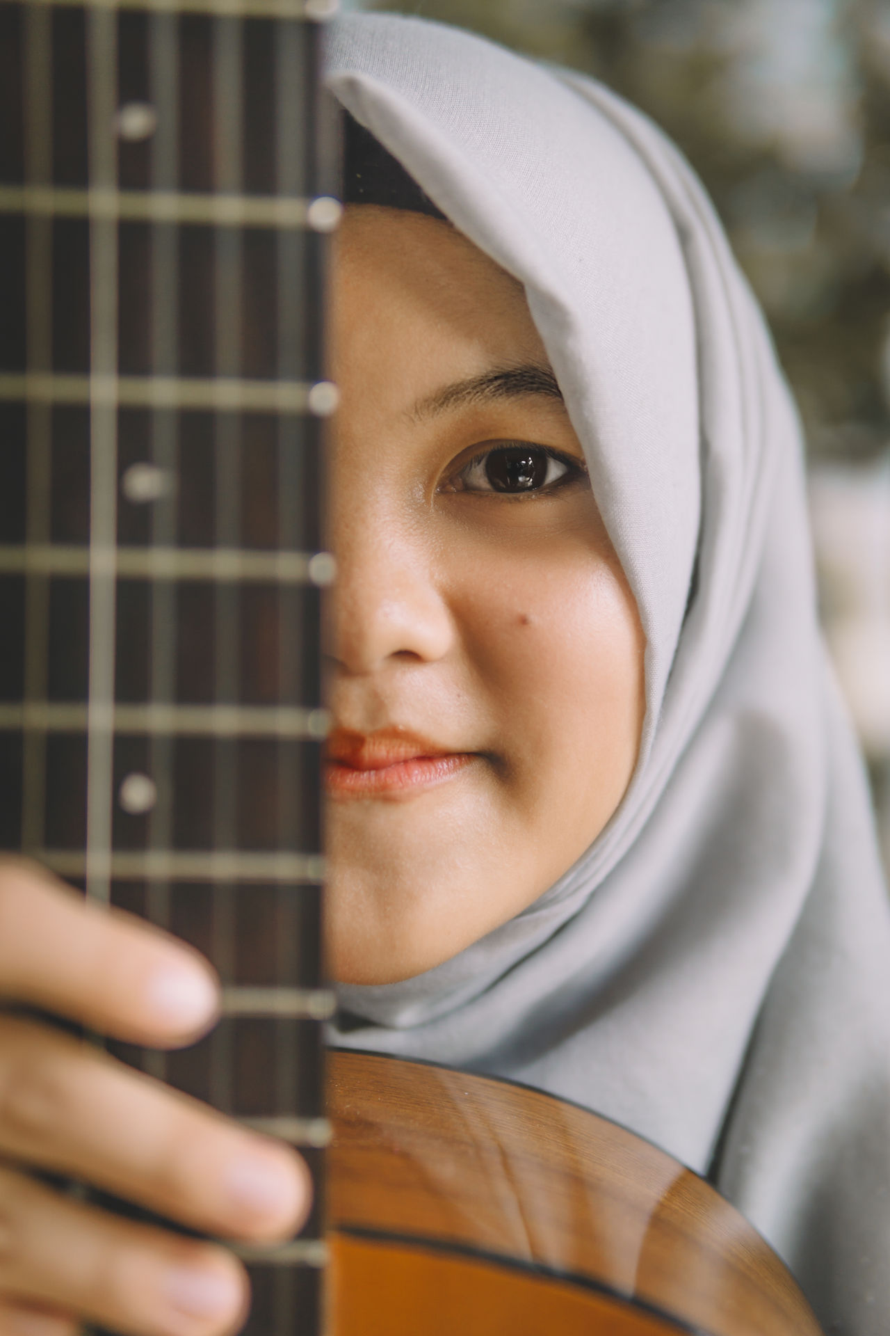 Adult Adults Only Arts Culture And Entertainment Close-up Day Eye EyeEmNewHere Full Length Girl Guitar Headshot Hijab Leisure Activity Lifestyles Looking At Camera Music Musical Instrument One Person Outdoors People Portrait Real People Standing Young Adult Young Women