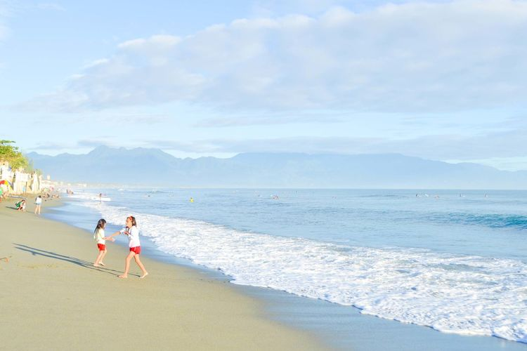 Beach is love Beach Beauty In Nature Cloud - Sky Coastline Day Fun Leisure Activity Mountain Mountain Range Nature Ocean Person Scenics Sea Shore Sky Summer Tourism Tourist Tranquil Scene Tranquility Vacations Water Wave Weekend Activities