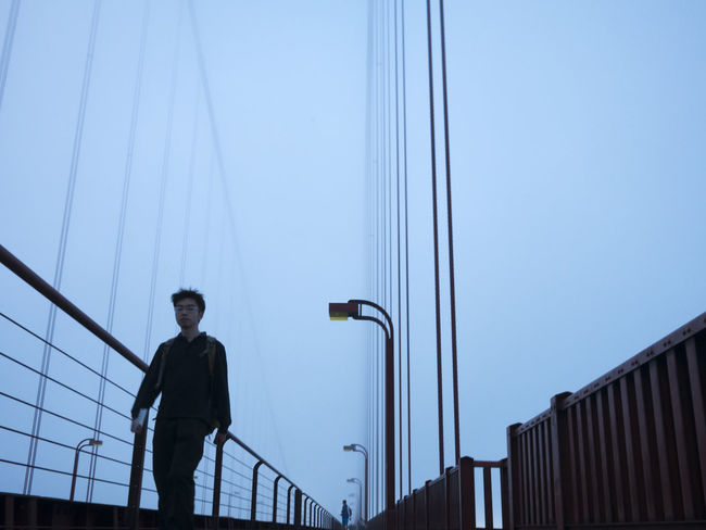 Abstract image of San Fransisco Golden Gate Bridge on a foggy day. Adult Architecture Built Structure Clear Sky Foggy Golden Gate Bridge Horizontal Night One Man Only One Person Only Men Outdoors Pedestrian People Person Portrait Real People Reliability San Francisco Sky Young Adult