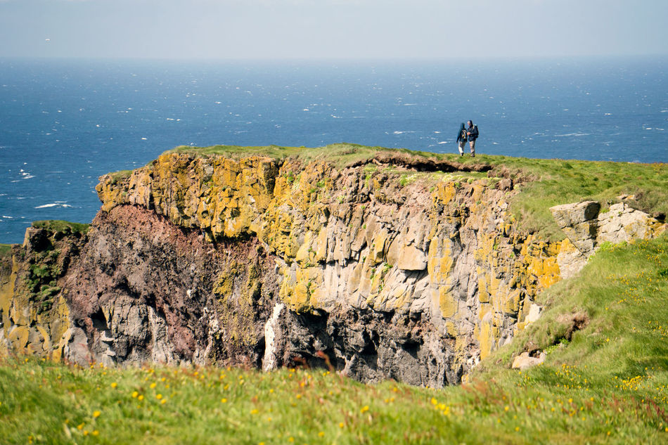 a couple on the cliffs of Latrabjarg, Iceland. Adult Adults Only Cliff Couple Day Grass Iceland Landscape Latrabjarg Men Nature One Man Only Outdoors People Real People Romance Sea